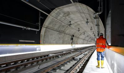 Construction worker or engineer in newly-built railway tunnel