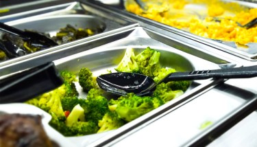 Food - Vegetables and macaroni cheese ready to be served in steel trays