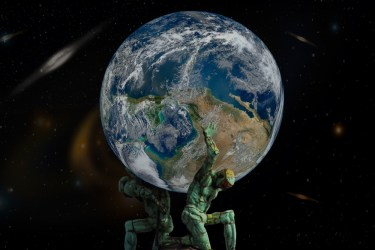 Kneeling statues of two humans holding up the Earth in space