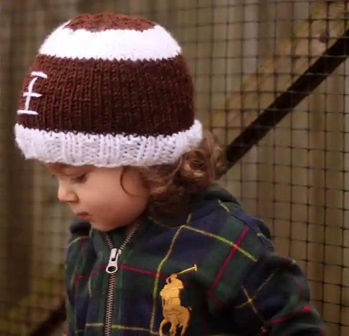 Football Baby Hat Free Knitting Pattern by blogger Gina Michele