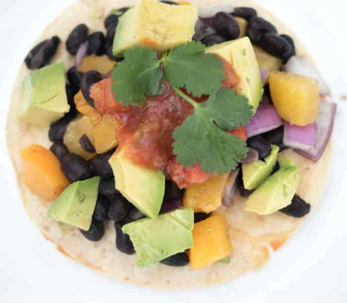 10 Minute Vegan Peach and Black Bean Tacos by blogger Gina Michele
