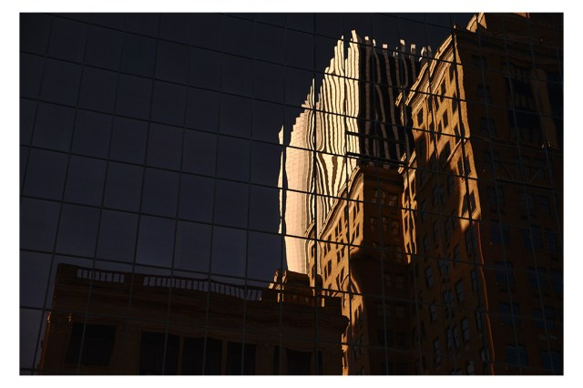 buildings reflected in windows