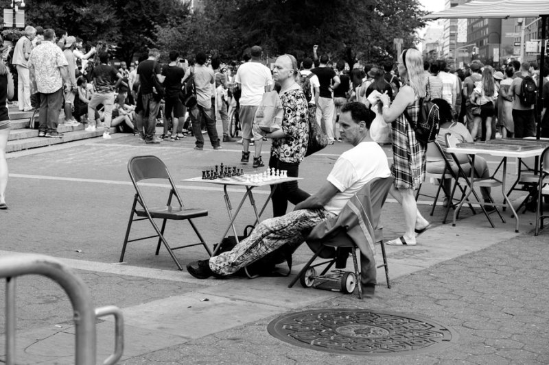 Chess player in Union Square waits for an opponent