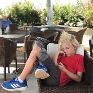 boy sleeping in a chair