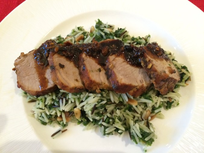 Fillet of pork, sliced and served on a bed of spinach, pinenuts and rice