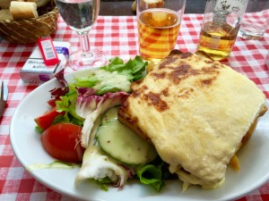 Shot showing a massive crock monsieur with delicious melting béchamel cheese topping. So yummy.