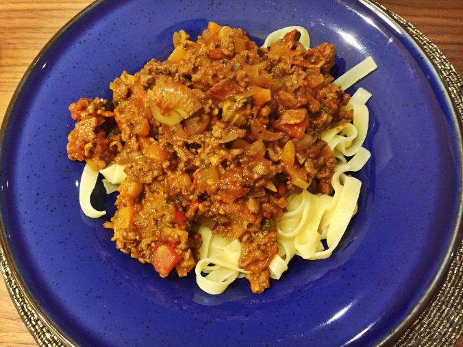 Shot showing the final dish of tagliatelle and bolognese sauce, looking delicious!