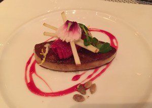 Shot of the beautiful foie gras, garnished with stunning pink hibiscus sauce
