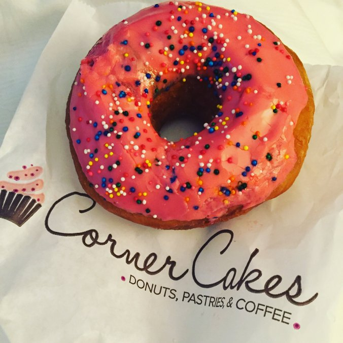 The brightest pink donut with sprinkles ever