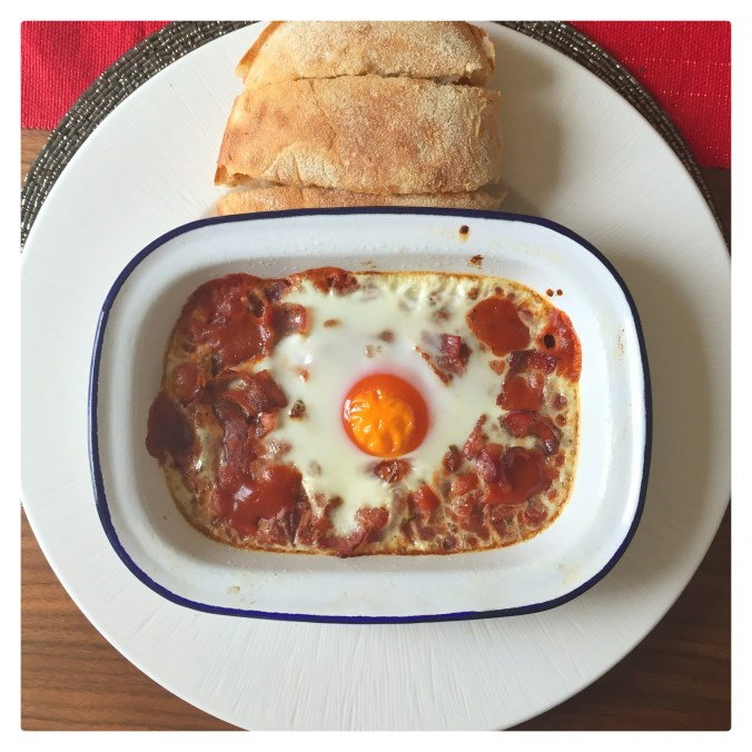 Ariel view of the shakshuka with a lovely baked egg and ciabatta toast