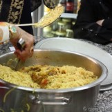 After the rice was cooked for 10 minutes in the oven, the chicken pieces are returned to the pot