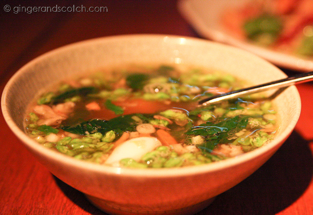 Clear soup of minced pork and prawns with pak warn and squid