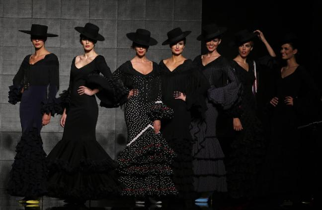 Models present creation by Rocio Peralta during the International Flamenco Fashion Show SIMOF in the Andalusian capital of Seville