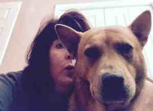 selfie of Ginger and dog Zivah up close