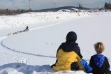 The boys watching a sled