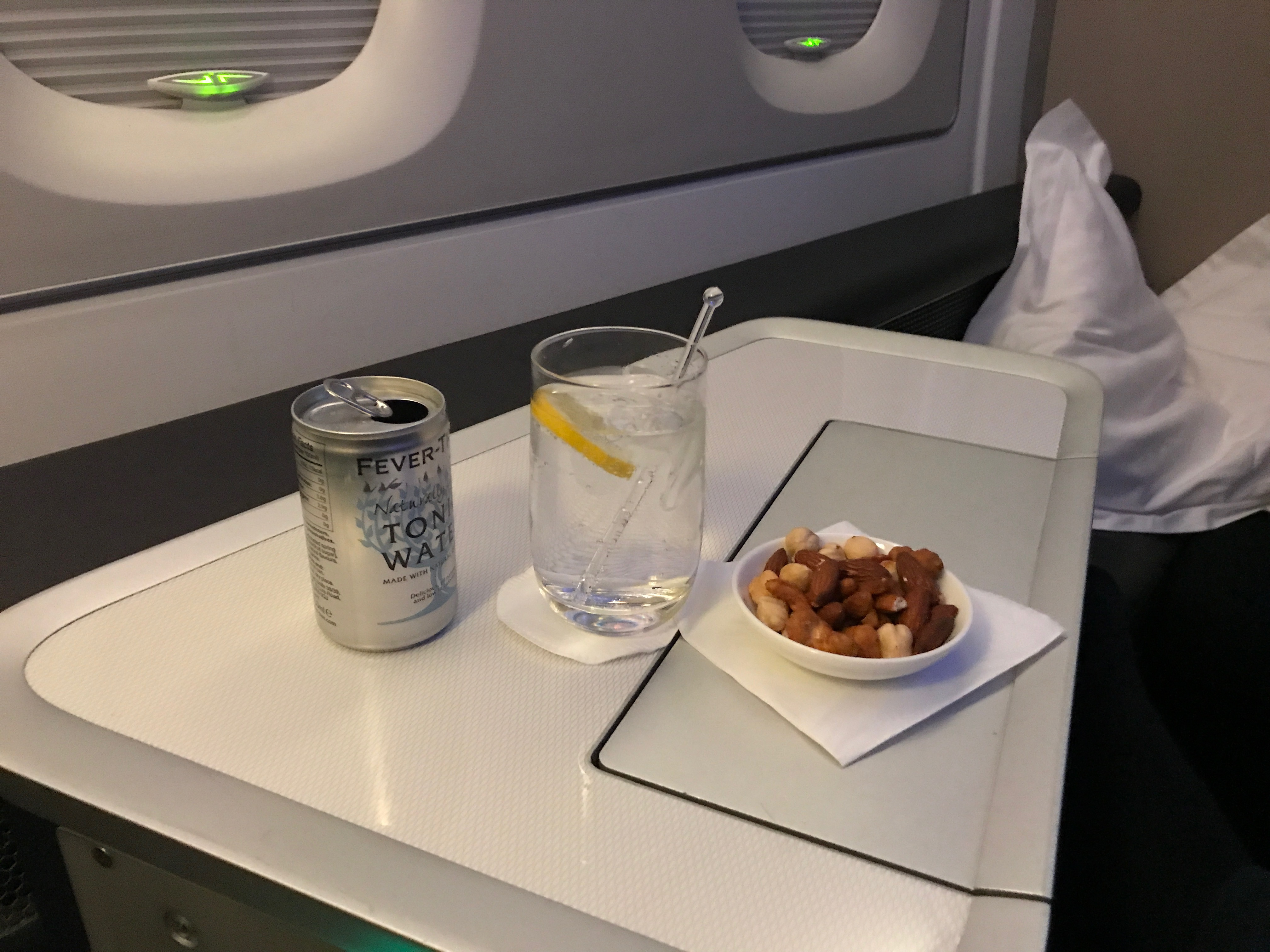 British Airways first class gin and tonic with warmed nuts