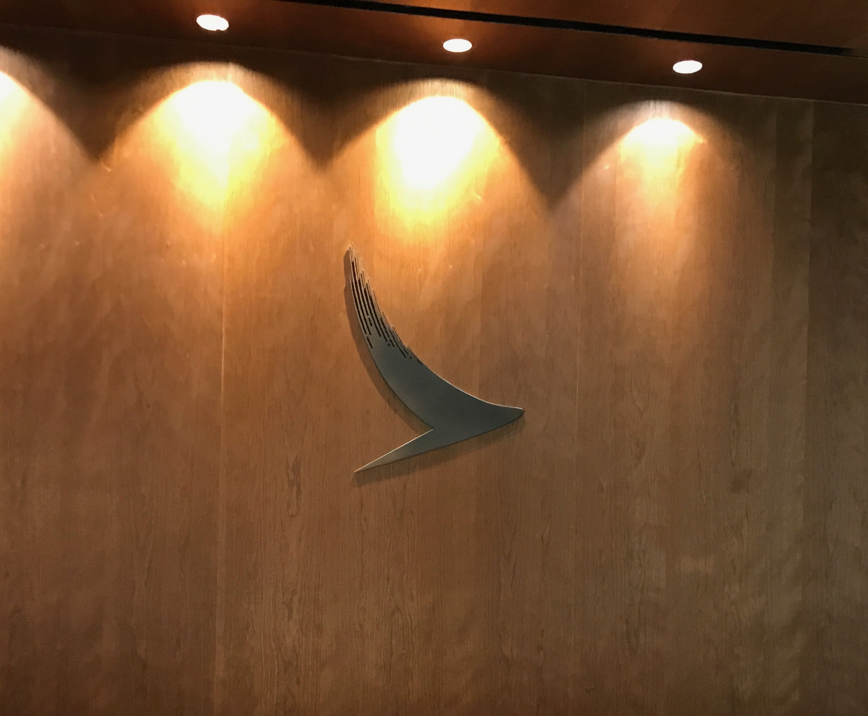 Cathay Pacific logo at the entrance to the Heathrow Terminal 3 lounge complex