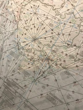 close up of an aviation chart in the JAL red suite Haneda