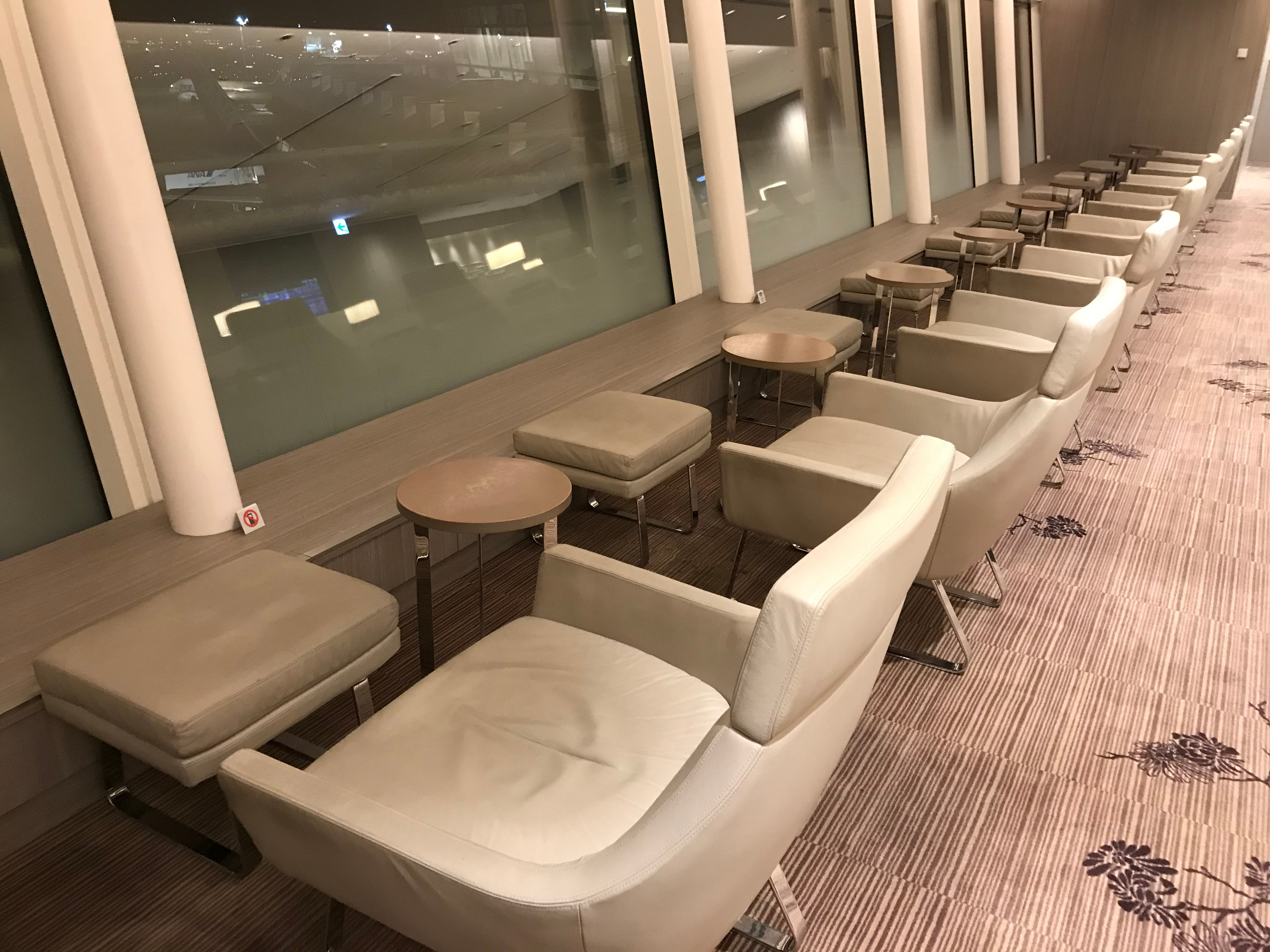 JAL First Class lounge Haneda seating with a view of the apron