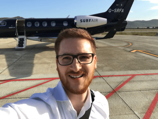 Ginger Travel Guru at Ibiza Airport with a Surf Air private jet