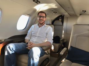 Ginger Travel Guru in a Phenom 300