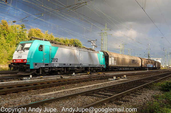 TRAXX F140 MS 186 204-4 also known as 2812 departs from Gremburg Yard, Köln, through a patch of sunlight under stormy skies on the 10th October 2013.