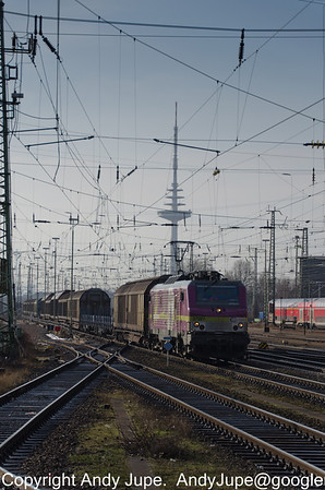 Alstom BB 37000, number 37027 approaches Bremen Hbf on the 12th of April 2013 with the Bremen-Walle Telecommunication Tower climbing 235 metres in the background