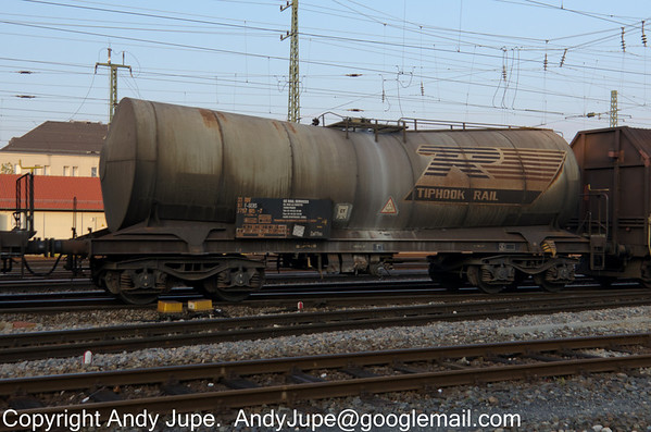 Tiphook Rail liveried depressed centre tank bogie wagon, number 33 87 7797 015-7 passes through Fürth (Bay) station on the 8th of October 2013