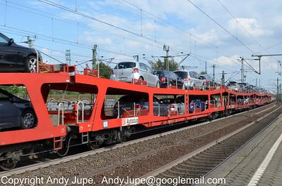 Autozug DDm 51 80 9880 015-5 passes through Hamburg Harburg station, Germany on the 18th July 2012