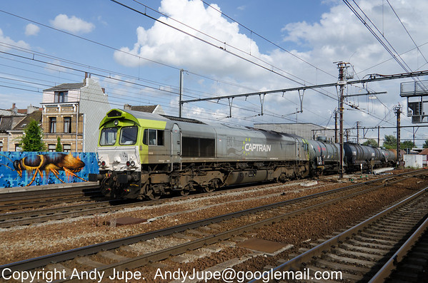 Captrain liveried 266 016-5 heads north through Antwerp-Berchem station in Belgium on the 29th of July 2013.
