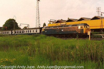 47 402 sits in Poole Carriage Sidings at the head of 1M87, the 20:40 hours Poole to Edinburgh sleeper service on the 24th of May 1991