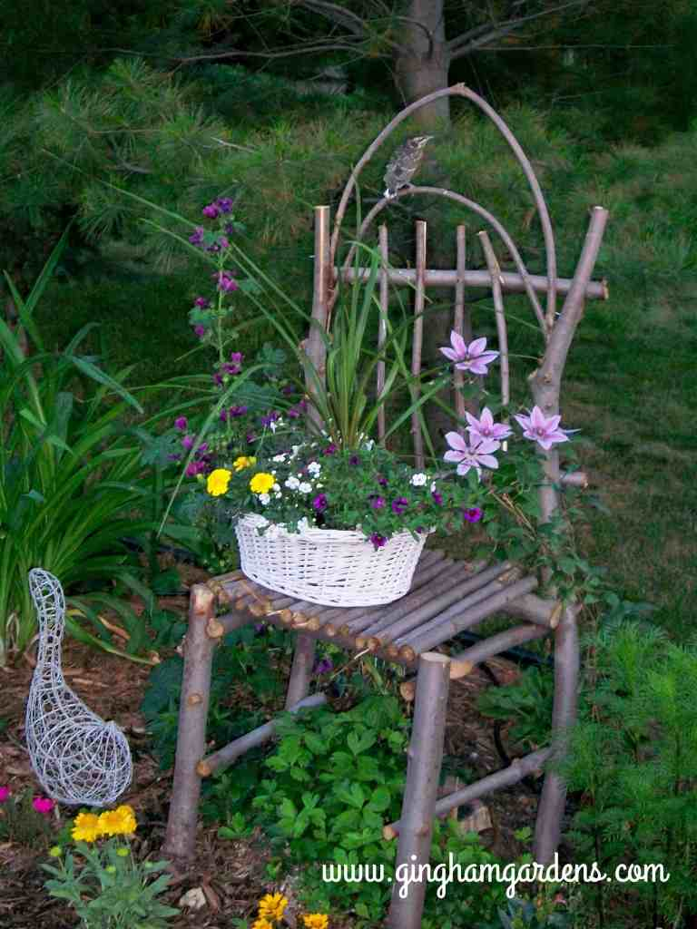 Garden Vignette using a DIY chair made from limbs and twigs.
