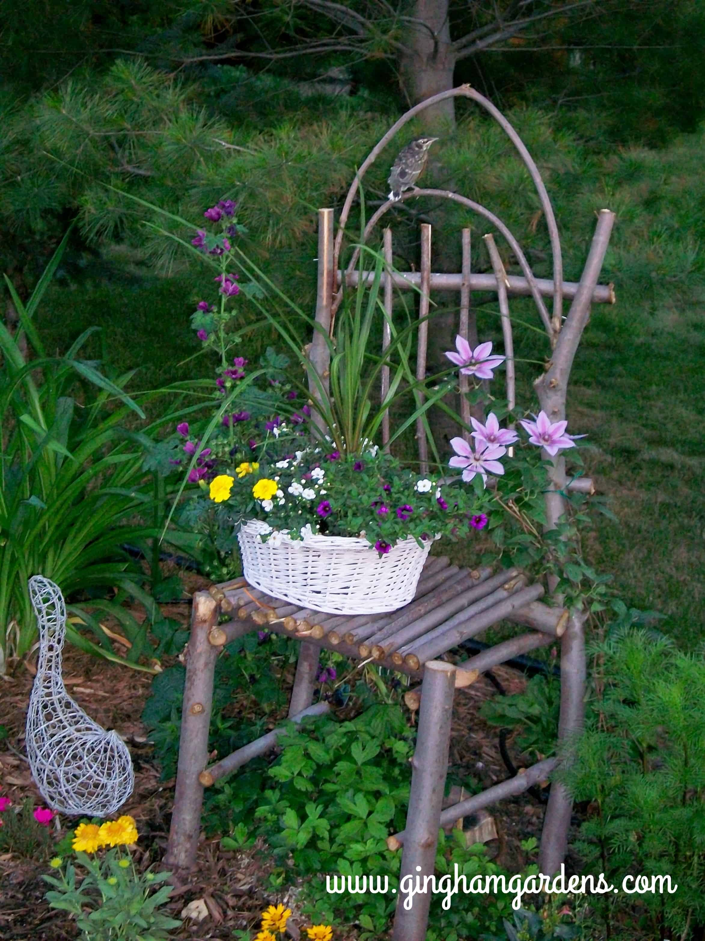 Chair Made From Maple Branches In A Flower Garden.
