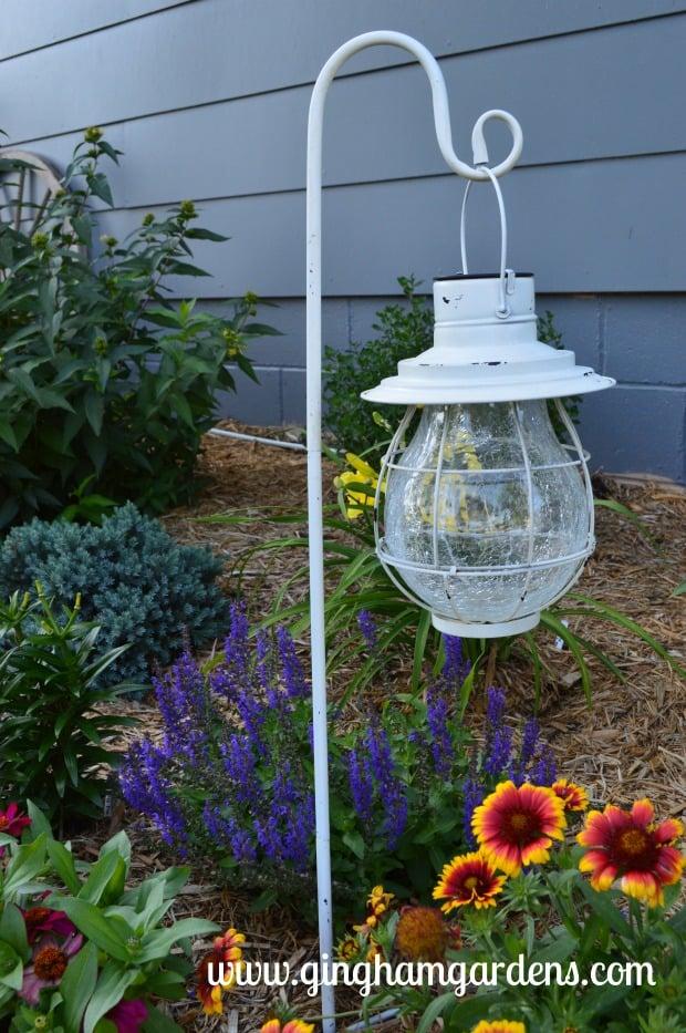 Garden Vignette at Gingham Gardens featuring hanging lantern