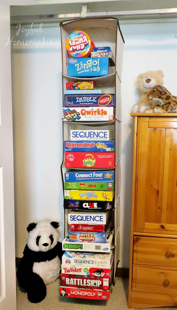 Boxes of board games and puzzles for toy storage ideas by GinGin & Roo