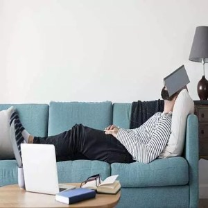 man taking a nap on couch