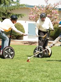 Ginny Prior and Steve Wozniak playing Segway polo