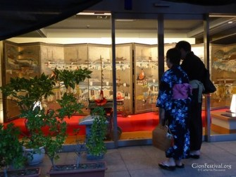yukata couple byobu matsuri folding screen company lobby gion festival kyoto japan