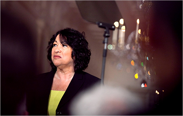 Sotomayor looks out at audience while the Teleprompter-in-Chief makes comments.