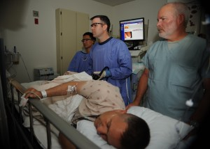 110405-N-KA543-028 SAN DIEGO (April 5, 2011) Hospitalman Urian D. Thompson, left, Lt. Cmdr. Eric A. Lavery and Registered Nurse Steven Cherry review the monitor while Lavery uses a colonoscope on a patient during a colonoscopy at Naval Medical Center San Diego. (U.S. Navy photo by Mass Communication Specialist 2nd Class Chad A. Bascom/Released)