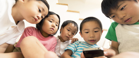 Children using a smart phone.