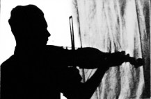 Dad with the Strad (my father playing his violin. Silhouette he took with a self-timer camera.)
