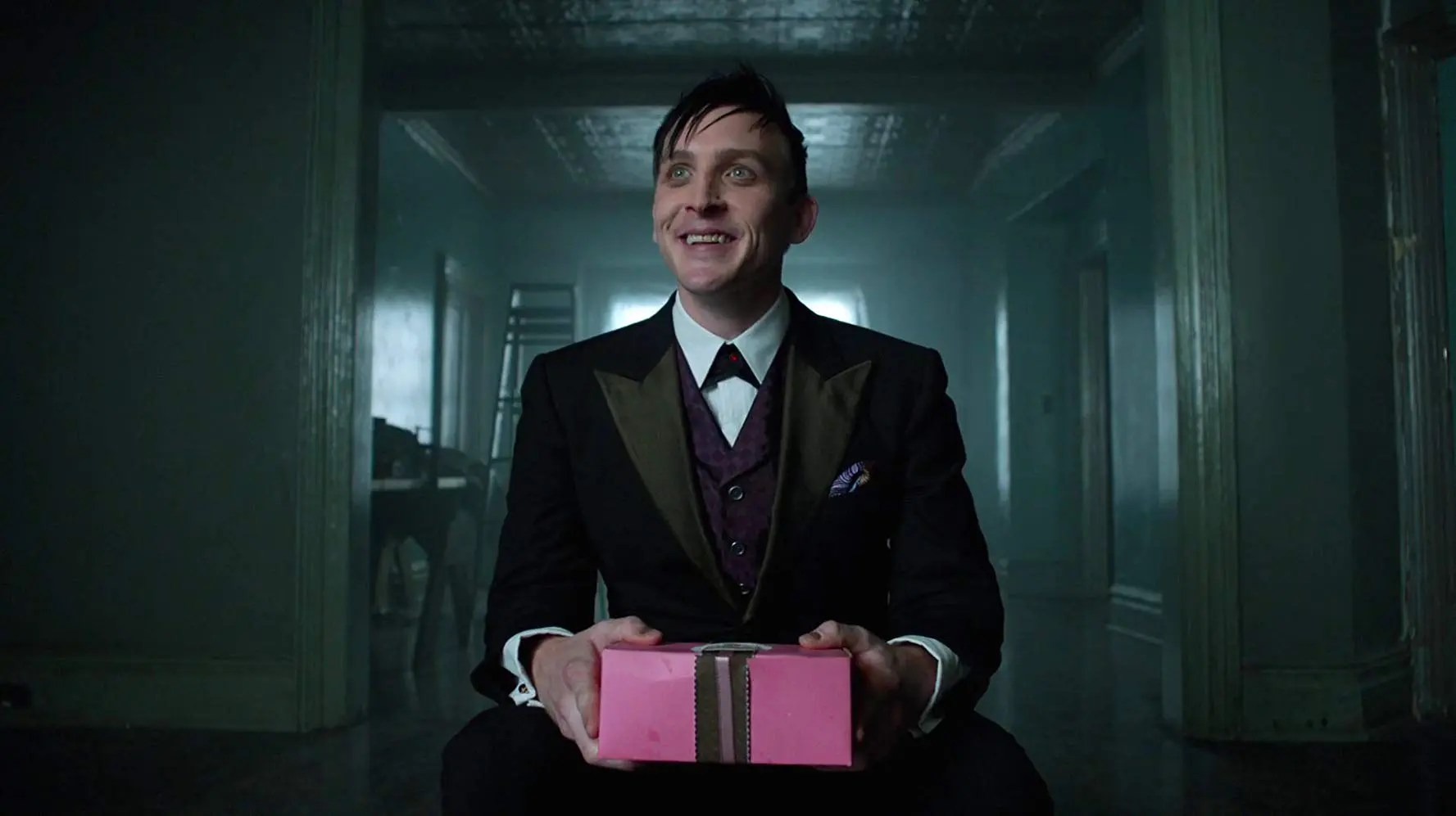 The Penguin holding a gift