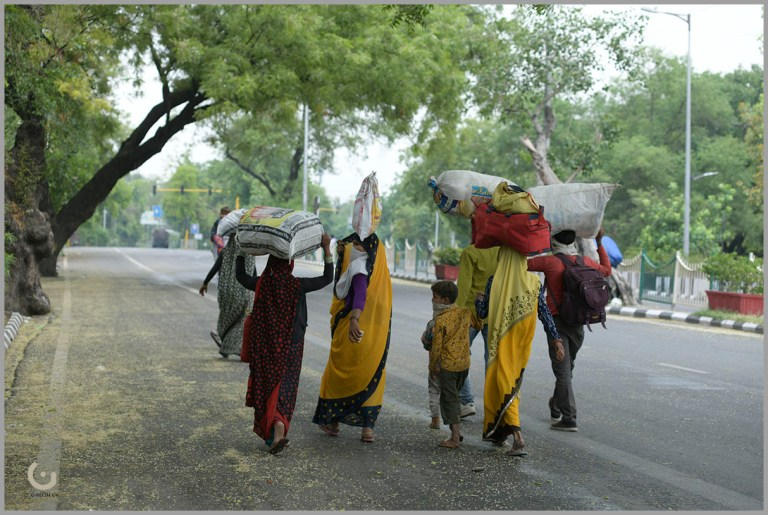 Walking towards ISBT to catch the bus for Panipat, if available, otherwise to walk till home. near ITO, Delhi ,on 3rd May2020