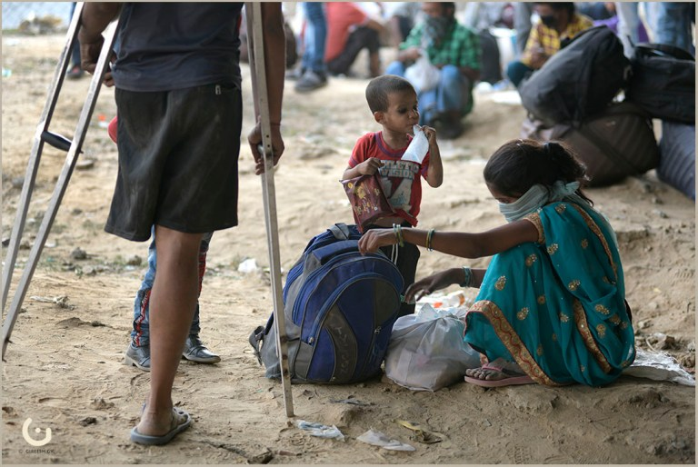 At Gazipur, differently abled migrant labourer with his wife and kid waiting to cross Delhi state border. on 18th May 2020