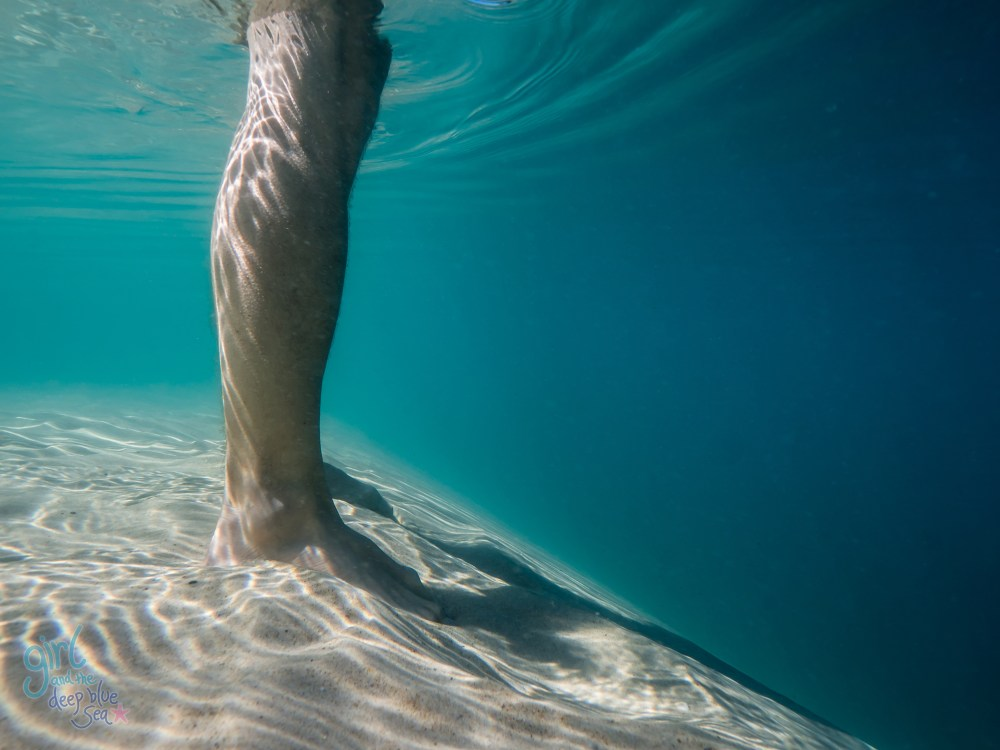 person standing in clear water
