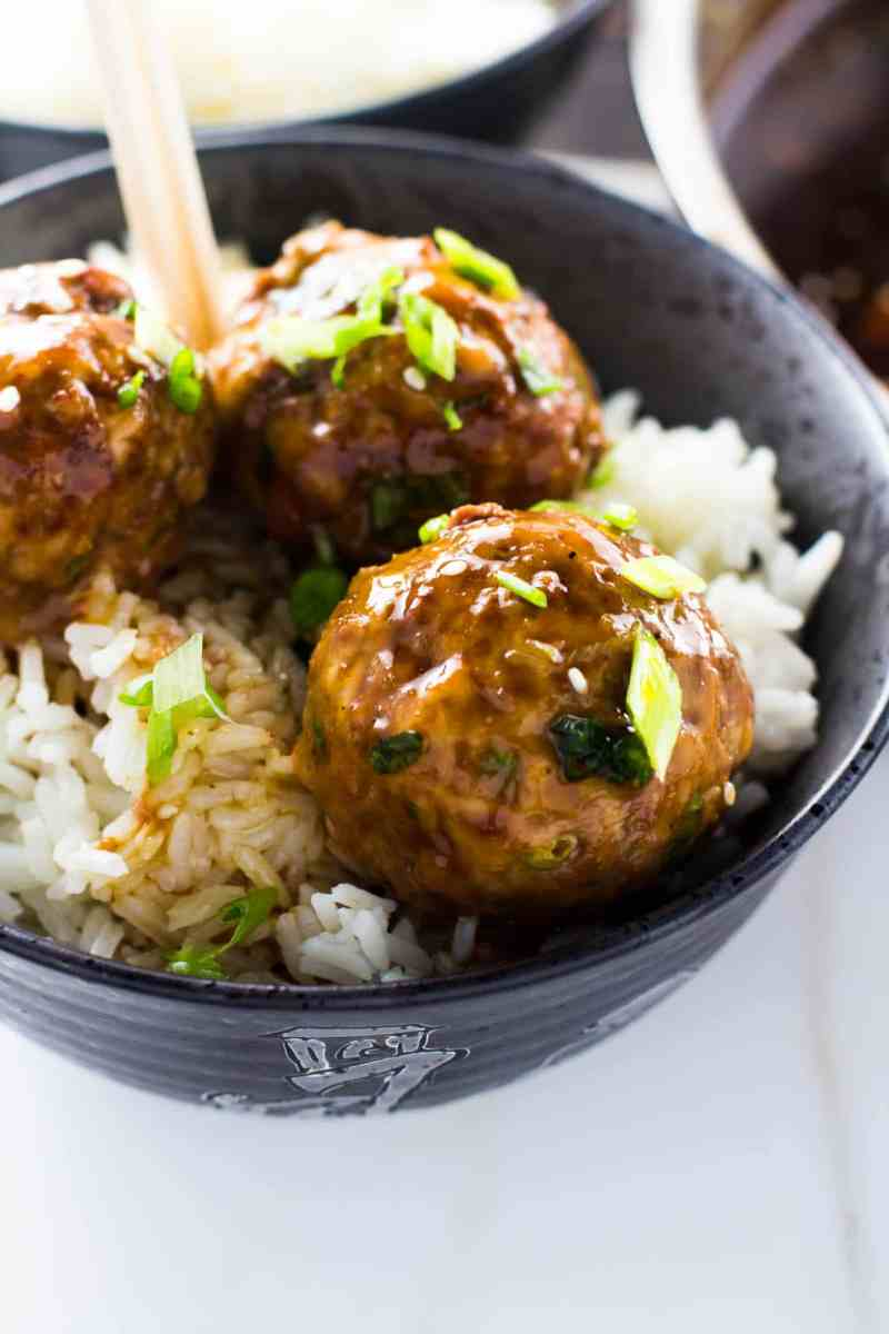 These fun and easy spicy Asian meatballs are juicy, tangy and spicy! They are baked right in the oven and dipped in an uber flavorful glaze to create the perfect party appetizer or a quick dinner!!!