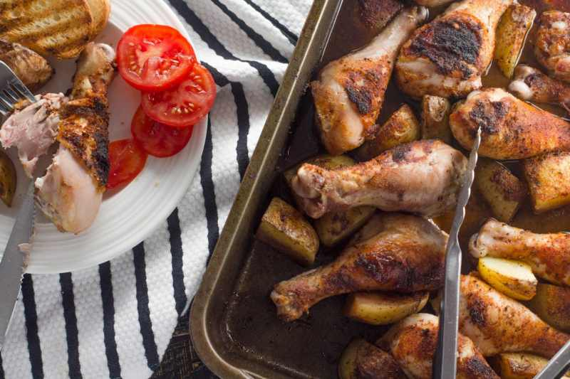 These one pot chicken thighs are ridiculously simple and so delicious! They are roasted until golden brown in a delicious Cajun red wine sauce!