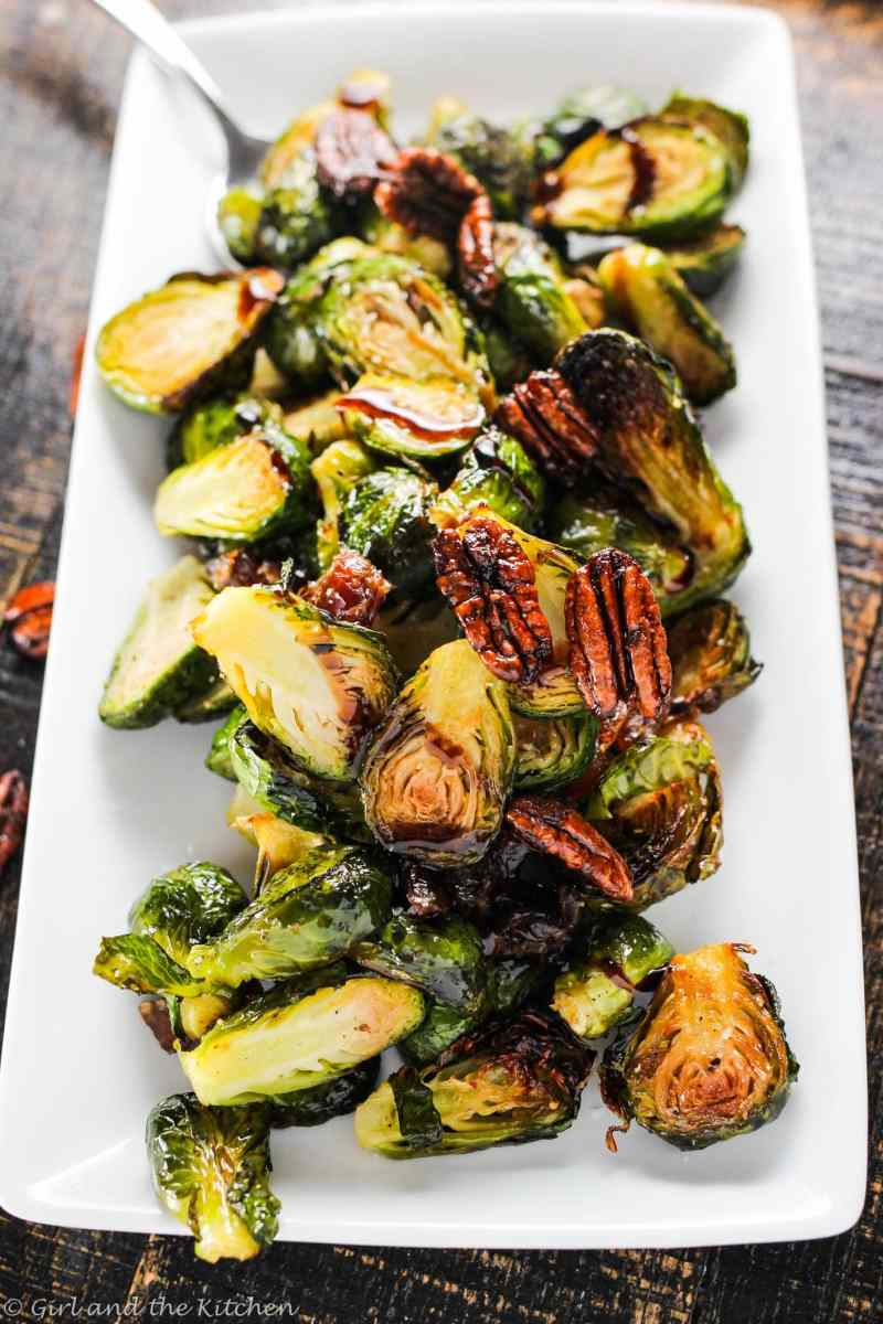 Perfectly crispy and tender Brussels sprouts that go from freezer to oven to done in under 20 minutes are the perfect party side dish or better yet entree for us plant based folk! Adorned with sweet dates and spicy caramelized pecans this dish is hard to compete with for the top veggie of the year!