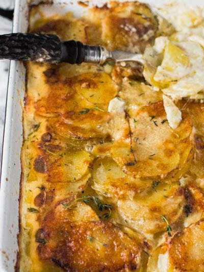These cheesy, dreamy potatoes are the ultimate potato casserole. Layers of thinly sliced potatoes, cheese, garlic and herbs make this super simple potato dish a winner for any occasion. The best part is there is about 15 minutes of active prep and this dish can be made days ahead of time! Total wins all around!